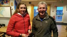 Laser Frostbite race winner, Radial sailor Claire Gorman from the National Yacht club collects her prize from DMYC's Neil Colin