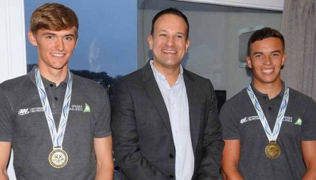 Seán Waddilove (right) with Taoiseach Leo Varadkar and 49erFX partner Robert Dickson at Howth Yacht Club in December