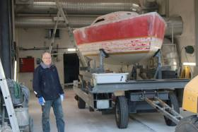 Birger Hansen with the restored hull of the first X-79 ready for paining