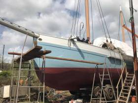 Removing the tarpaulin from Ilen as work continues on the historic vessel