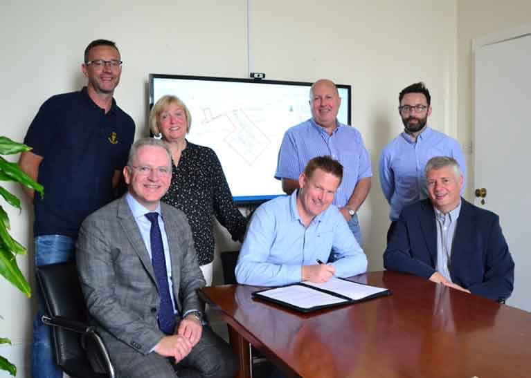 Signing the contract for Cobh Marina: Richard Marshall, Anne Ahern, Micheál O'Driscoll and Damian Ahern, committee members of Cove Sailing Club, with Paul Murphy of Byrne Looby and local councillor Cathal Rasmussen