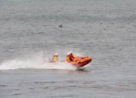 Wicklow RNLI's inshore lifeboat launches to the incident at Silver Strand yesterday afternoon