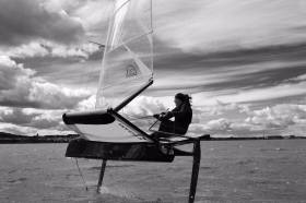 Annalise Murphy sailing a foiling Moth dinghy off Dun Laoghaire