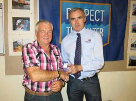 Mattie Stafford left, pictured with Declan Dixon from the RNLI when he received his 20 years Long Service Medal in recognition of his time spent on the lifeboat crew