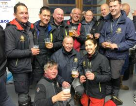 Aurelia's crew celebrate their runner-up slot in the Race Office in Dingle at 4.30 am this morning. Noted crew additions Maurice The Prof O'Connell of North Sails and Peter Ryan of ISORA are in middle of back row, while just visible on extreme right in background is Mark Pettit of current overall leader Rockabill VI