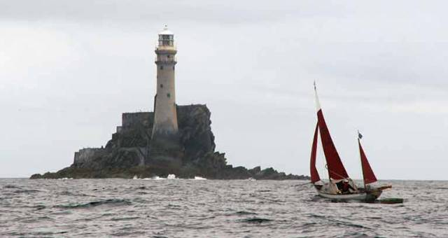 Jack O'Keeffe's Drascombe approaching the Fastnet Rock
