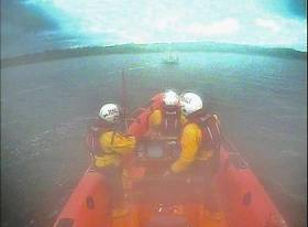 The lifeboat crew set up an astern tow and took the boat from the rocks and into safe waters