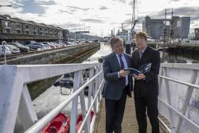 Minister for Marine Micheal Creed and Dr Stephen Hynes co-author of the report and Director of SEMRU (NUIG) discussing the latest figures from the 2019 Ireland's Ocean Economy Report which was launched yesterday above at Cork City Marina.