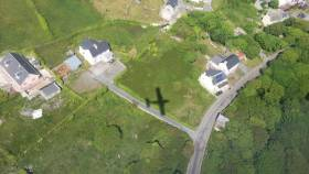 Aerial shot over Aran Islands with shadow of aircraft