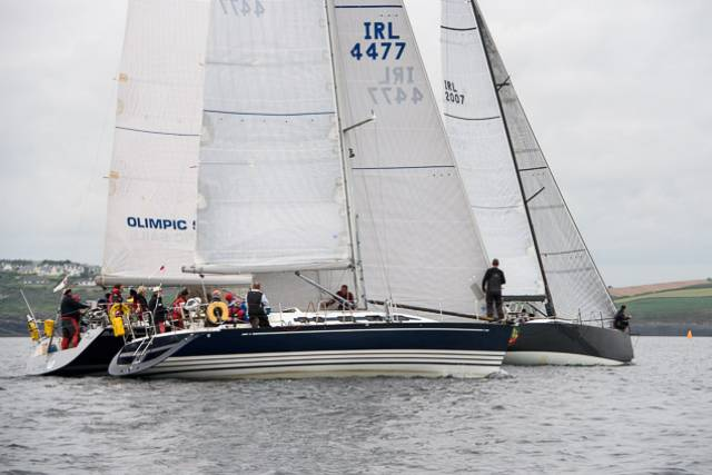Jump Juice with Prof O'Connell on helm (and David Harte calling tactics) gets ahead of KYC Commodore Tom Roche sailing Meridian with Conor Doyle to weather in Freya. Scroll down for photo gallery