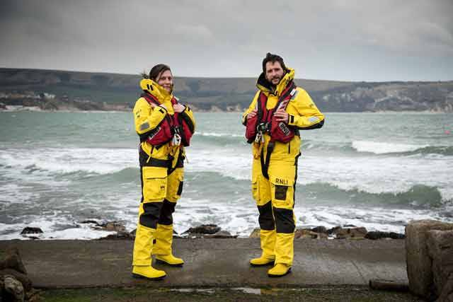Two RNLI crew wearing the new Helly Hansen gear