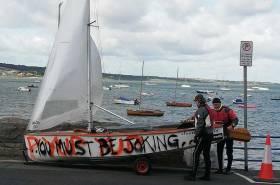 Is this GP14 crew commenting on the decision to launch in the big winds last Saturday? In fact, the 'graffiti' on Des McMahon's hull is the first few lines from a song by Irish rappers,Versatile
