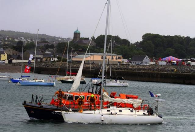 Wicklow's all-weather lifeboat towing the stricken yacht into Wicklow Harbour