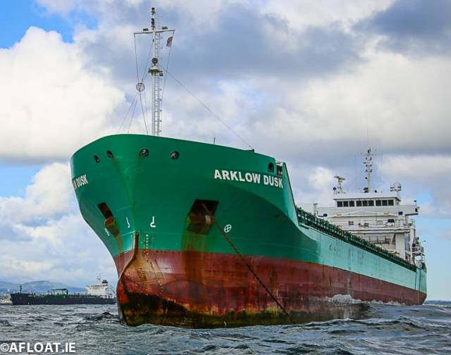 At close quarters: Gone is the grey hull colour of former owner's Flinter Group whose cargsoship is now Arklow Dusk. The Irish flagged ship had made its first call to Dublin Port and was one of seven ships that presented a busy scene in Dublin Bay over the May Bank Holiday weekend.