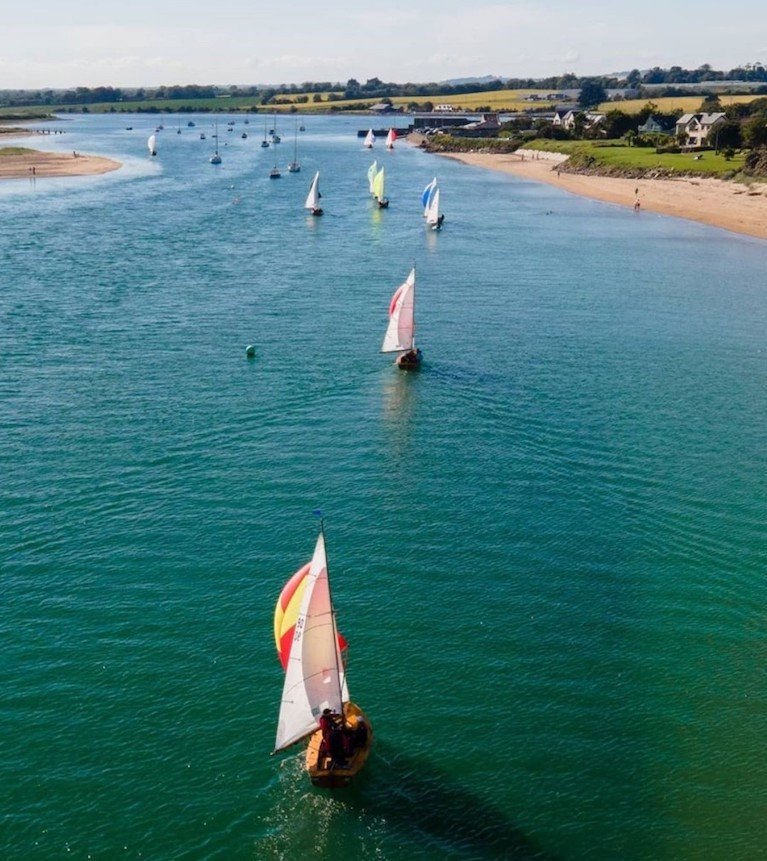 Aerial drone image of the Mermaid fleet on the way back to Rush Sailing Club