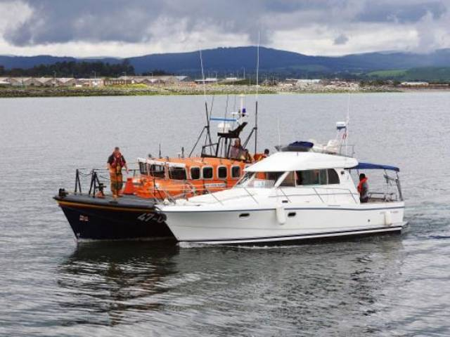 Wicklow RNLI's all-weather lifeboat taking the cruiser under tow