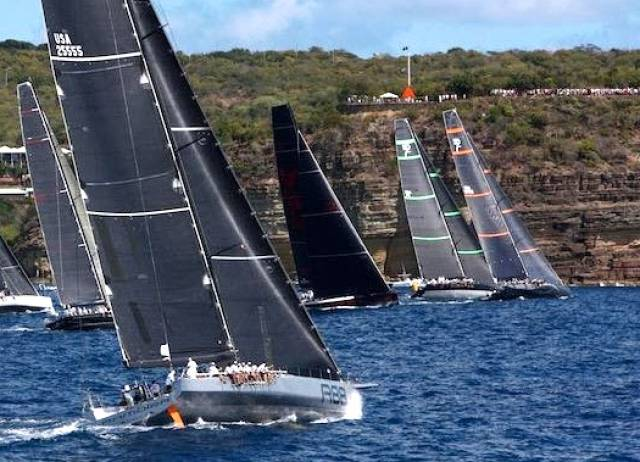 """The Race of the Year"". Shortly after the start of the RORC Caribbean 600, with the big boats hard on the wind and closing the cliffs of Antigua. George David's Rambler 88 (foreground) was to go on to take line honours, but ahead of her at this stage are Bella Mente (US 45) and Proteus, locked together right in on the land, with Bella Mente about to call for water and tack with control over Proteus."