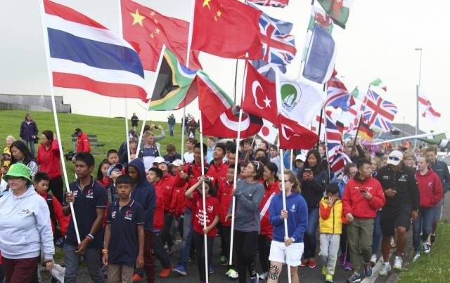 Topper sailors from around the world parade at Ballyholme Yacht Club