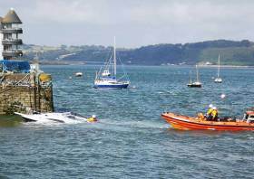 Youghal RNLI set up a tow for the sunken boat