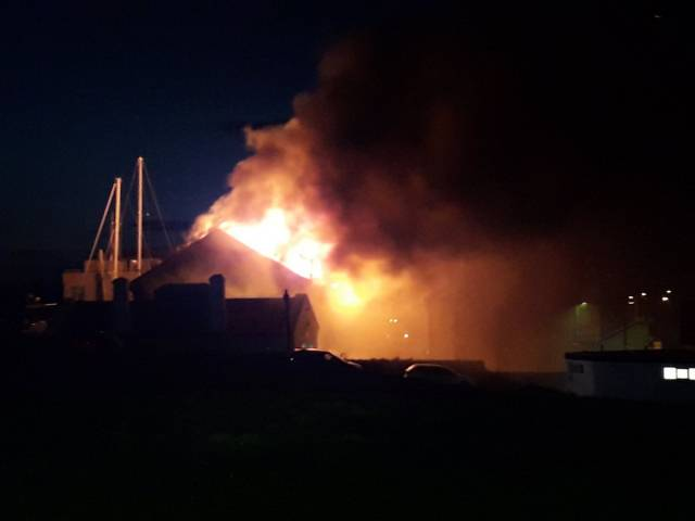 The scene in north Wales as a fire devastates a workshop premises in Holyhead Marina.