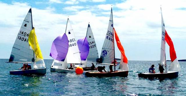 GP14s negotiate a gybe mark at Skerries during the Leinster Championships