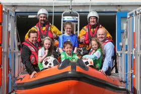 GAA personalities Marty Morrissey and Anthony Daly with local GAA players at Kilrush RNLI