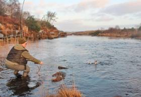 Michael McCann about to land the first salmon of the season on the Lackagh River in Co Donegal