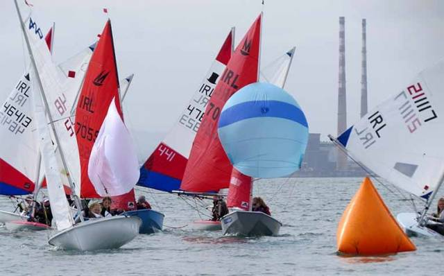 Mixed dinghies converge on a leeward mark