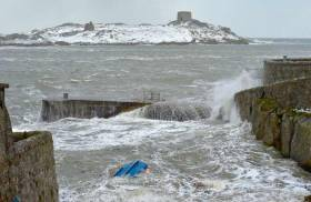 A scene from Coliemore Harbour on Dublin Bay during Storm Emma