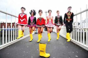 Tara Brady, Doireann Ní Ryan, Allah Marsh, Ava Lawrence, Ella Kennedy and Ronan O'Brien pictured dancing in RNLI yellow wellies on the Ha'penny Bridge in Dublin