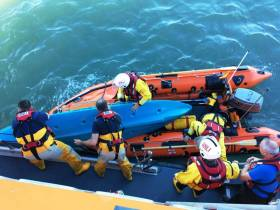 RNLI volunteers assist one of the three kayakers who attempted to aid the rescue of the injured teenager Courtown Harbour