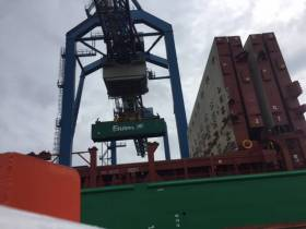 Unloading of containers from a EUCON lo-lo vessel, Elbetrader at the Port of Rotterdam.