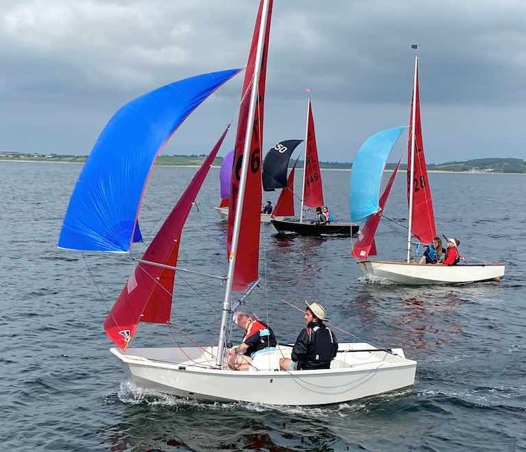 """The Hat"" in his hot glass boat…Caolan Croasdell and Fiona Drayne (Lough Ree YC) on their way to winning the Mirror Nats, with Chloe & Fionn Murphy (also Lough Ree and fourth overall) close aboard, and the black-hulled Blue Away (David Evans & Jack Draper, Sligo YC, 5th overall) chasing them both"