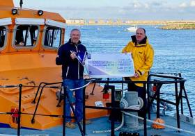 Swords Sailing & Boating club Vice Commodore Patrick Wodhams presents a cheque to Steven Harris of Howth RNLI