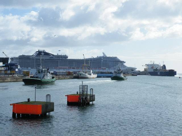 The massive cruiseship MSC Splendida compared to a P&O Ferries vessel preparing to berth in Dublin Port