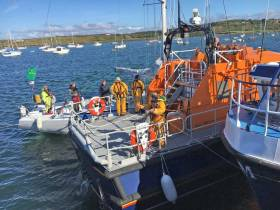 Baltimore RNLI safely secures the stricken Fastnet Race yacht in Baltimore Harbour