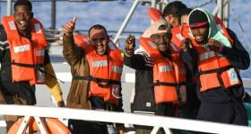 Some of the 49 migrants who had been stranded on the 'Sea-Watch 3' react towards the media as they disembark from a Maltese patrol boat yesterday.