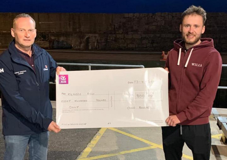 Kilkeel RNLI's LOM John Fisher receives the cheque from Craig Boucher
