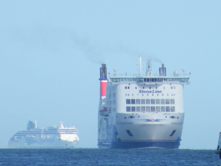 The 'Ferry Faces' of Stena Line's 'Seamaster' class Stena Adventurer arrives in Dublin Port ahead of Irish Ferries Ulysses when approaching in Dublin Bay. Both ferries compete on the core Irish Sea short-service route linking Holyhead, north Wales.