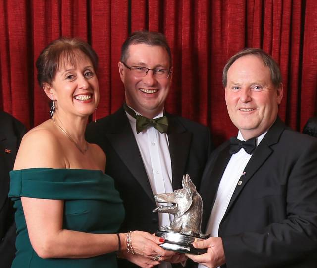 Mojito co-skippers Vicky Cox and Peter Dunlop receiving the Wolf's Head Trophy from Peter Ryan of ISORA at the annual awards ceremony in the National YC in November