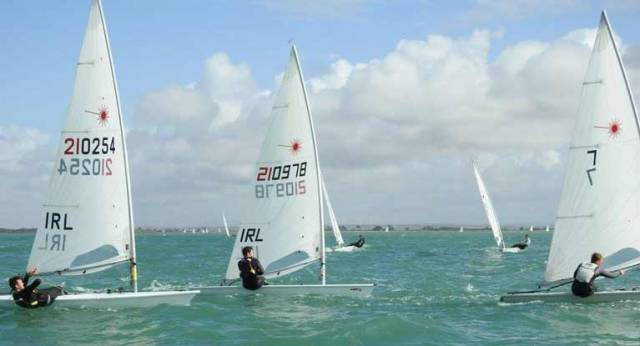 Lynch (IRL 210978) on his way to bronze in the Bay of Cadiz. Ballyholme's Liam Glynn (210254) is to weather as the boats approach a weather mark