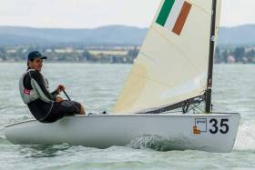 Fionn Lyden helming his Finn dinghy on Lake Balaton, Hungary. The Baltimore sailor is lying fourth overall at the U23 World Championships