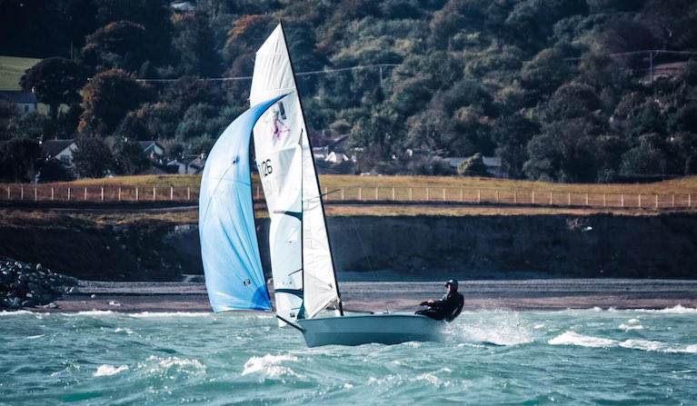 An RS400 dinghy planing on a reach in great breeze at Greystones Bay, County Wicklow