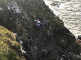 The teenage girl is lifted to safety by Coleraine Coastguard's rope rescue specialist