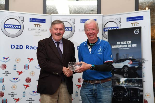 Dun Laoghaire Dingle overall winner Paul O'Higgins (right), skipper of the defending champion yacht JPK10.80 Rockabill VI from the Royal Irish Yacht Club is presented with the The Volvo D2D Race Trophy by Billy Naughton of Volvo (Billy Naughton Motors) Tralee. Scroll down for photo gallery