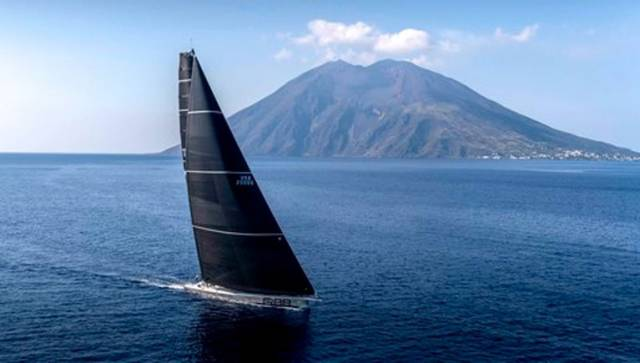 George David's Rambler 88 arrives at Stromboli – she was soon virtually becalmed for hours, but now has all the wind she needs