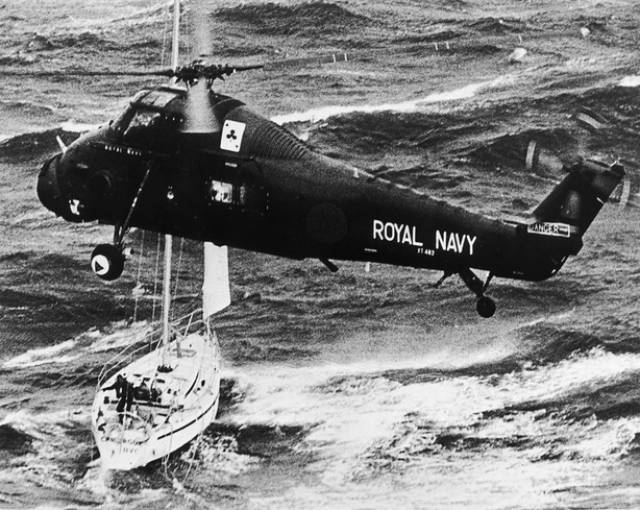 "Fastnet '79 Yacht Race Disaster: A Royal Navy helicopter rescues the crew of the yacht ""Camargue"" during the Atlantic storm in August 1979"