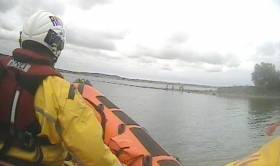 Portaferry's inshore lifeboat arrives on scene to rescue the women and children cut off by the tide
