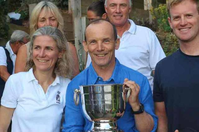 Howth's Laura Dillon (left) with Grant Gordon with the Trevor Wade Trophy on day two of the Dragon Edinburgh Cup at Torbay
