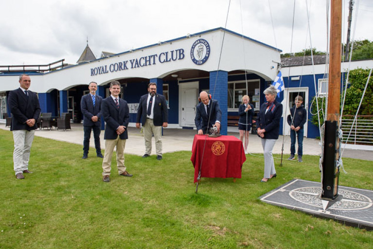 At the socially-distanced noonday ceremony at Royal Cork Yacht Club on Sunday to consign Volvo Cork Week 2020 to history were (left to right) Kieran O'Connell (Vice Admiral RCYC and Chairman Volvo Cork Week 2020), George Mills (Johnson & Perrott and Volvo), Ross Deasy (Director of Racing – Keelboats Cork300), Colin Morehead (Admiral RCYC & Chairman Cork300), Daragh Connolly (at signal cannon, Rear Admiral Keelboats RCYC), Megan O'Sullivan (Optimist sailor, RCYC), Annamarie Fegan (Rear Admiral – Dinghies RCYC) and Harry Moynan (Optimist sailor RCYC).